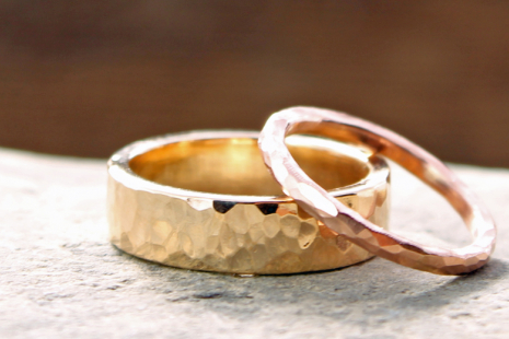 custom artisan hammered rustic wedding bands in 14k yellow and rose gold