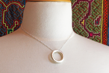 artisan hammered silver circle pendant