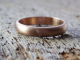artisan 14k rose gold wedding band with recycled gold