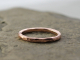 artisan hammered 14k rose gold wedding band and stacking ring