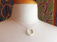 artisan silver circle pendant with hammered sterling silver