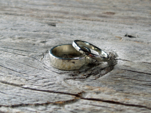 his & hers artisan hammered sterling silver wedding band set