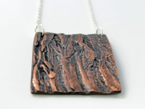 rustic rectangle copper necklace with cedar bark pattern