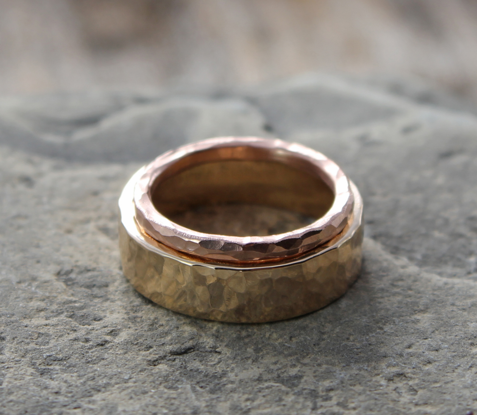 his & hers custom 14k yellow and rose gold hammered wedding band
